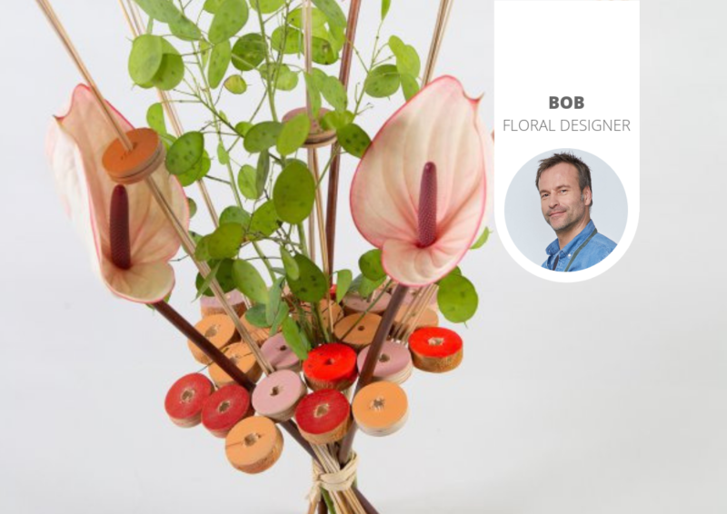 Anthurium bouquet in frame of wooden discs