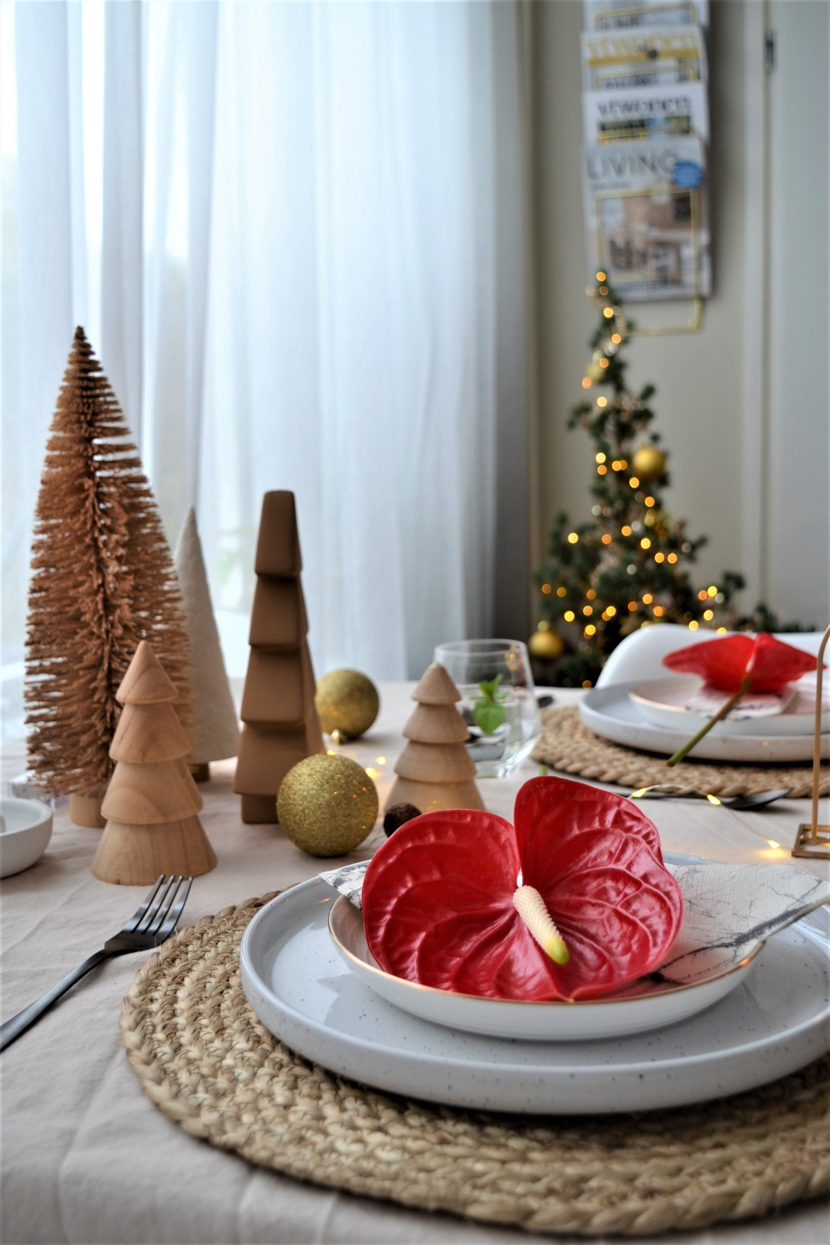 Christmas table setting with red Anthurium flowers