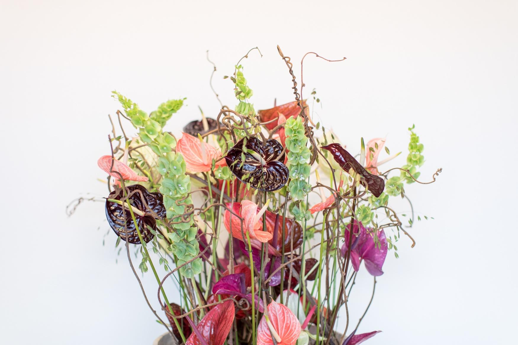 Een bloemstuk met anthurium snijbloemen: 3 voorbeelden