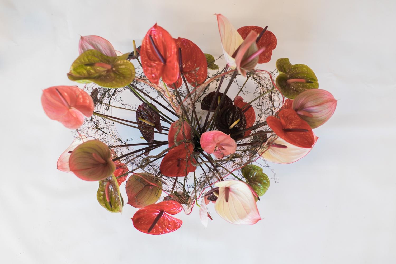 A flower arrangement using cut Anthurium flowers: 3 examples